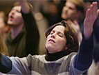 woman hands raised, praising god in worship and prayer