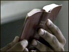 daily Devotion small red leather Bible held in hands